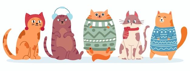Słodkie koty w swetrze szczęśliwe grube kocięta na nowy rok i świąteczny baner wektorowy