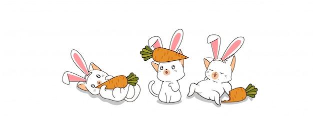 Słodkie króliczkowe koty są zadowolone z marchwi w wiosenny dzień