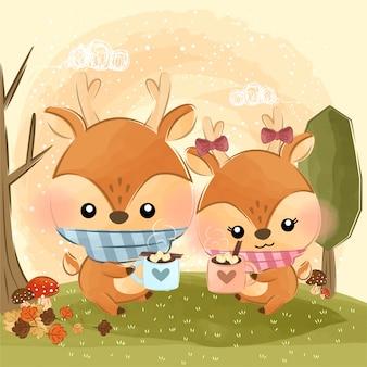 Słodkie małe jelenie i gorące czekoladki