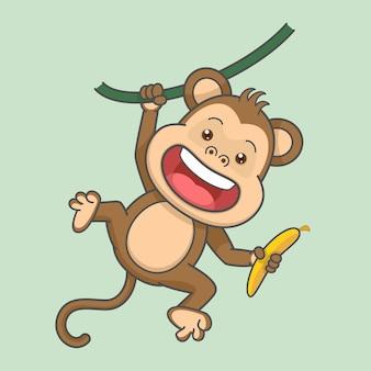 Słodkie wiszące małpy trzymające banana