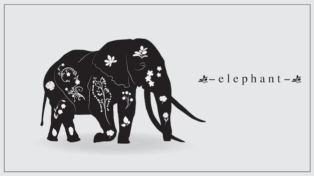 Słoń w kolorze czarnym z białymi kwiatami i roślinami.