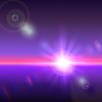 Słońce nad horyzontem z rozbłyskami obiektywu