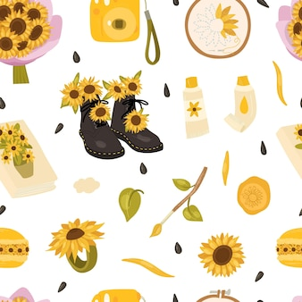 Słonecznik wzór z bukietem kwiatów aparat farby olejne pędzle notebook makaronik hoop haft koperty.