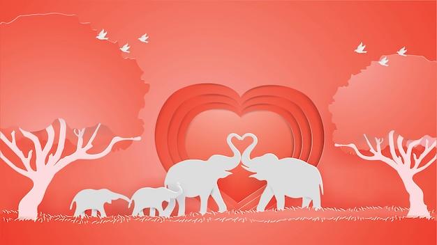 Słonie pokazują miłość na czerwonym tle serca.
