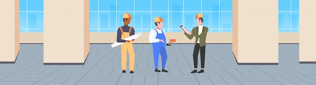 Słowa kluczowe: pracownicy drużyna wnętrze rasa nowy budynek horyzontalny mieszanka pojęcie teamwork podczas spotkanie budowa hełm przemysłowy rasa teamwork technicy pojęcie nowożytny sztandar folował spotkanie _