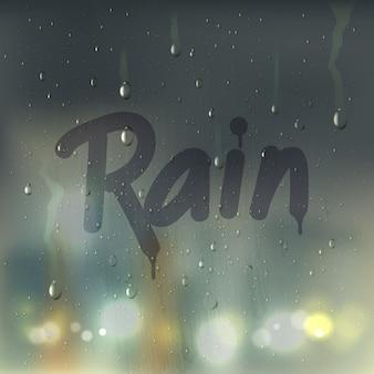 Słowo deszczu na zamglonym składzie szkła