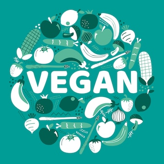 Słowo wegańskie otoczone owocami i warzywami.