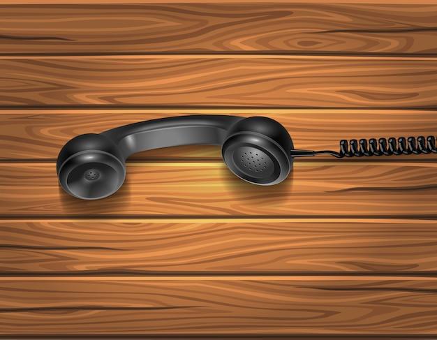 Słuchawka na drewnianym tle