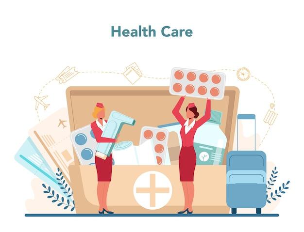 Służba zdrowia stewardessy. piękne stewardesy pomagają pasażerowi w samolocie.