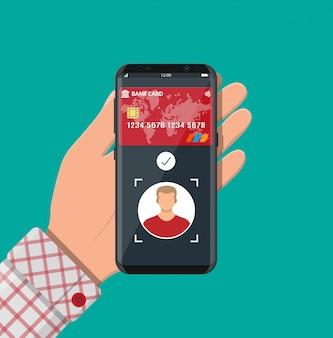 Smartfon z aplikacją płatniczą wykorzystującą rozpoznawanie twarzy i identyfikację w dłoni. biometryczny identyfikator twarzy. bezprzewodowe płatności zbliżeniowe lub bezgotówkowe, rfid nfc. ilustracja płaski styl