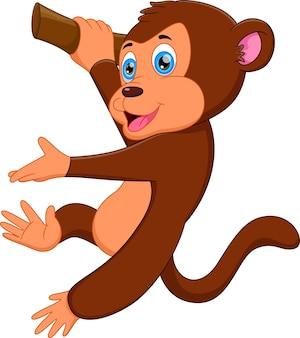 Śmieszna małpa wisząca na drzewie