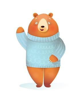 Śmieszne dzieci niedźwiedź noszenie dzianinowego swetra stojącego, machającego na powitanie, zimę i boże narodzenie dla dzieci z życzeniami. wesoła ilustracja zwierząt dla dzieci, kreskówka w stylu przypominającym akwarele.