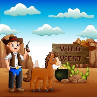 Śmieszny kowboj z koniem na kamienistej pustyni