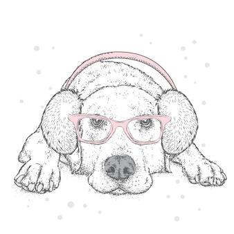 Śmieszny szczeniak w zimowych słuchawkach. ilustracji wektorowych.