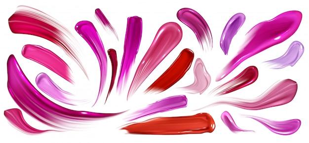 Smugi szminki, lakieru do paznokci lub farby, zestaw pędzli na białym.