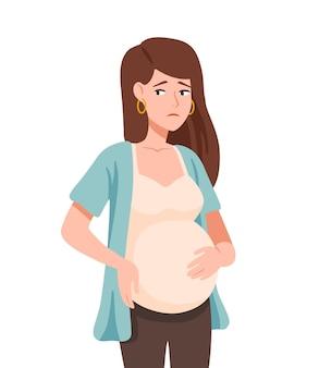 Smutna młoda kobieta w ciąży na białym tle
