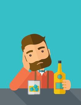 Smutny człowiek sam w barze pije piwo.