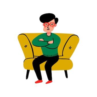 Smutny młody człowiek na kanapie