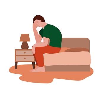 Smutny samotny depresyjny mężczyzna siedzący na łóżku ból głowy depresja i zdrowie psychiczne psychiczne