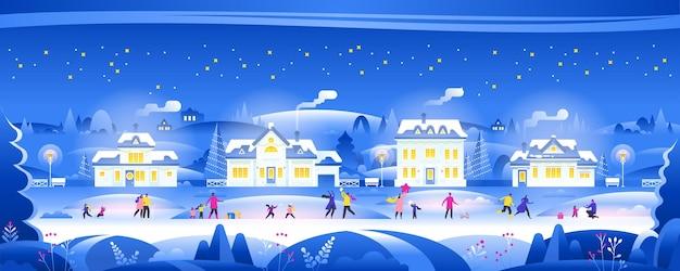 Śnieżna noc z ludźmi w przytulnej panoramy miasta zimowy krajobraz wsi w nocy