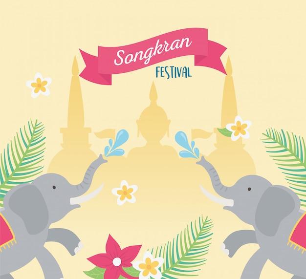 Songkran festiwalu słoni woda bryzga świątynnych buddha kwiaty