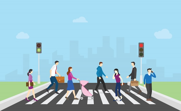 Spacer pieszy po drugiej stronie ulicy z zespołem ludzi i sygnalizacji świetlnej i miasta