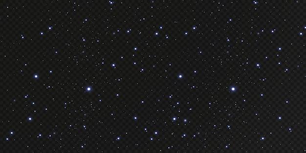 Spadają świąteczne złote konfetti, błyszczące gwiazdy latają po nocnym niebie pośród odblasków świetlnych punktów przestrzeni. tło wakacje. magiczny połysk.