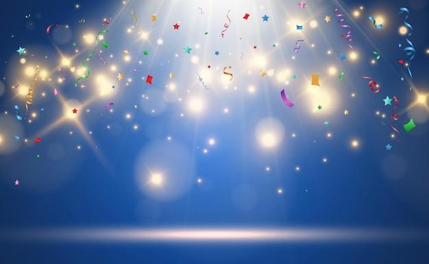 Spadające konfetti na niebieskim tle