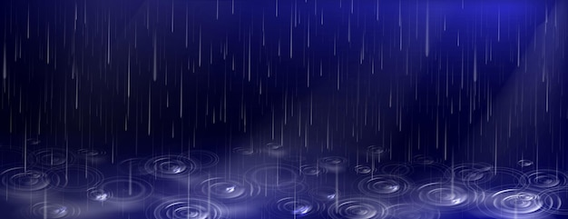 Spadające krople wody i kałuże zmarszczki na ciemnym niebieskim tle