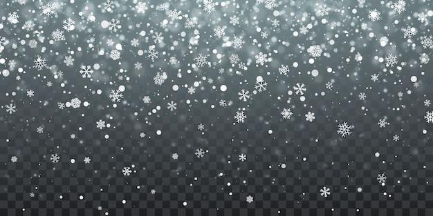 Spadające płatki śniegu na niebieskim tle. opad śniegu
