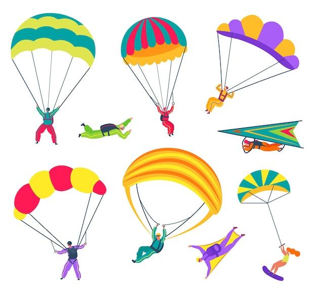 Spadochroniarze ze spadochronami latający w niebie zawodowi paralotniarze skoczkowie w wingsuitach