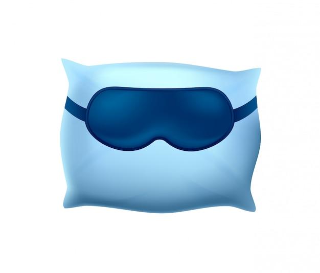 Śpiąca maska na niebieskiej poduszce na białym