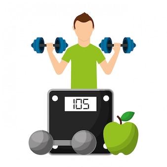 Sportowiec z owocami i hantle wybierając zdrowy styl życia