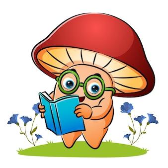 Sprytny grzybek czyta książkę w ogrodzie ilustracji
