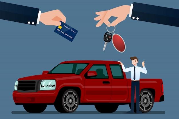 Sprzedawca samochodów sprzedaje ciężarówkę pickupa.