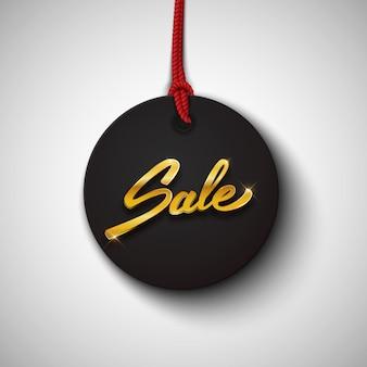 Sprzedaż czarny tag lub etykieta ze złotym tekstem