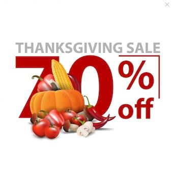 Sprzedaż w święto dziękczynienia, do 70% taniej, biały stylowy baner rabatowy z dużymi czerwonymi liczbami z jesiennymi zbiorami