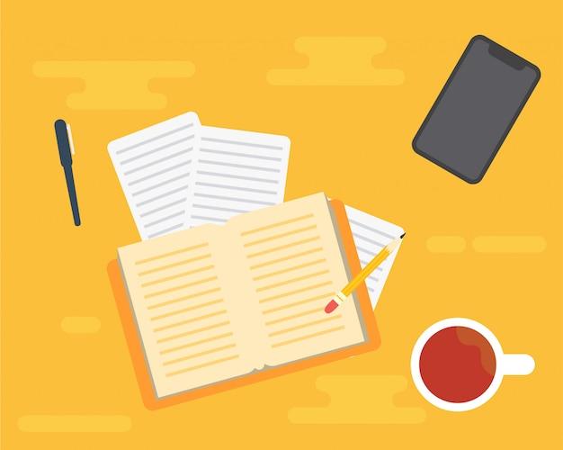 Sprzęt w biurze. książka, filiżanka kawy i telefon komórkowy