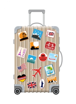 Srebrna torba podróżna. plastikowa obudowa z naklejkami.