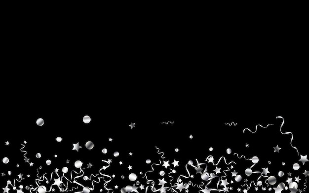 Srebrne konfetti latające na czarnym tle