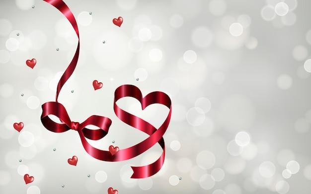 Srebrne tło bokeh, wstążki w kształcie serca i perła na białym tle