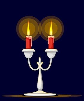 Srebrny kandelabr z płonącą czerwoną świecą