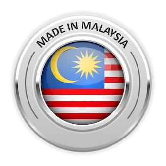 Srebrny medal made in malaysia z flagą