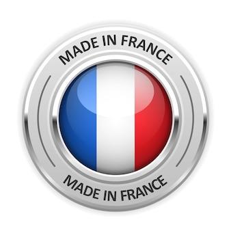 Srebrny medal wyprodukowano we francji z flagą