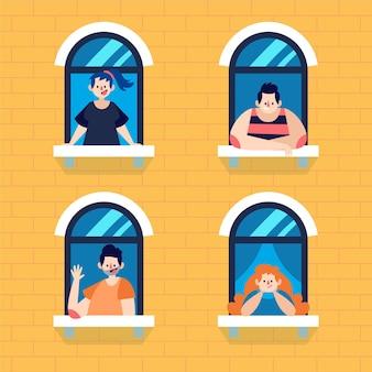 Średni widok osób stojących przy ich oknach