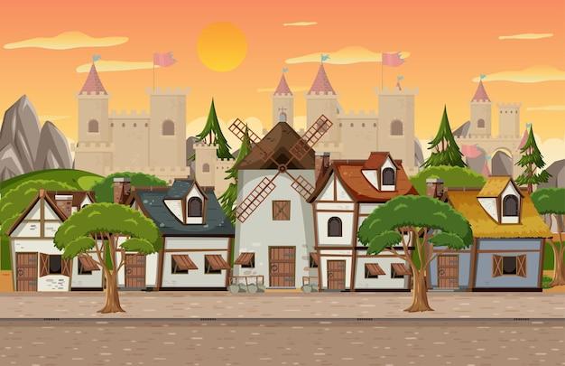 Średniowieczna scena z wiatrakiem i domami