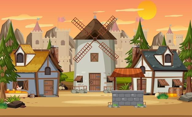 Średniowieczna wioska z wiatrakiem i domami