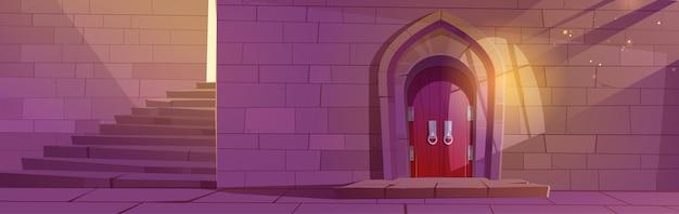Średniowieczne wnętrze lochu lub zamku z drewnianymi łukowymi drzwiami, kamienne schody i ceglany mur wejściowy do pałacu ze światłem słonecznym wpadającym przez zakratowane okno bajkowy budynek z kreskówkową ilustracją