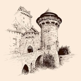 Średniowieczny kamienny zamek z wieżami nad morzem i mostem.