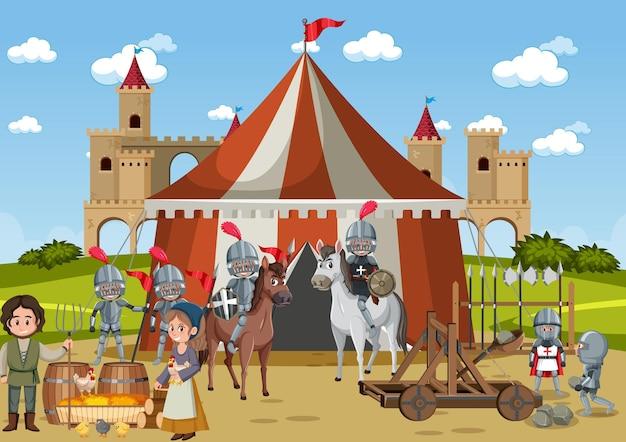 Średniowieczny obóz wojskowy z namiotem i mieszkańcami wioski